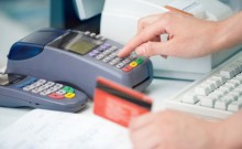 merchant-using-credit-card-machine